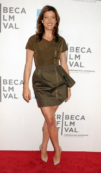 Kate Walsh in olive green