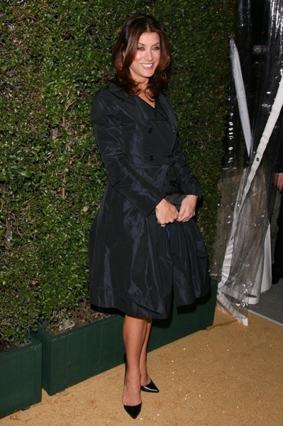 Kate Walsh in black trench