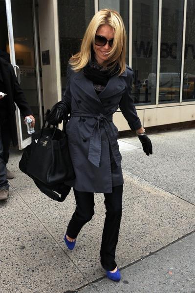 Kelly Ripa in black trench coat