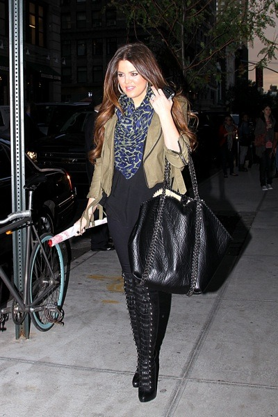 Khloe Kardashian in lace-up boots
