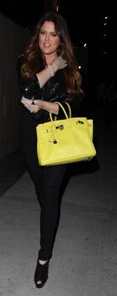 Khloe Kardashian with yellow bag