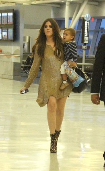 Khloe Kardashian in gold studded boots