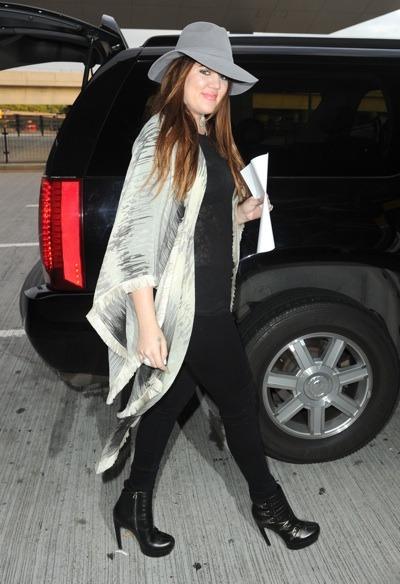 Khloe Kardashian in grey fedora