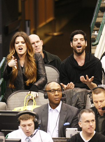 Khloe Kardashian cheering on Lamar Odom