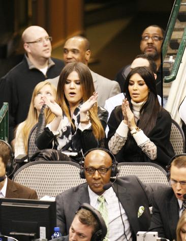 Khloe Kardashian and Kim Kardashian attend a Dallas Mavericks game