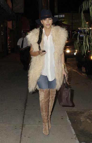 Kim Kardashian in tan suede boots