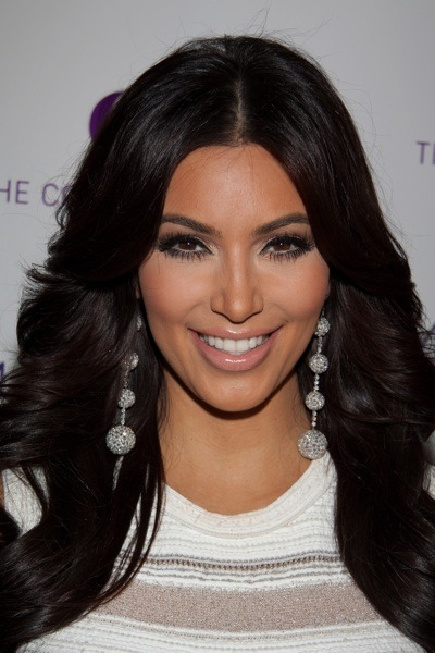 Kim Kardashian in drop ball earrings