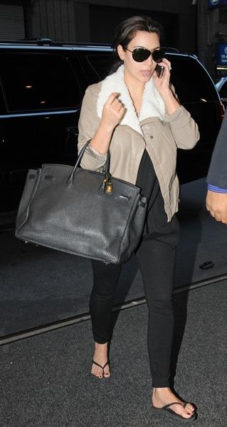 Kim Kardashian in bomber jacket