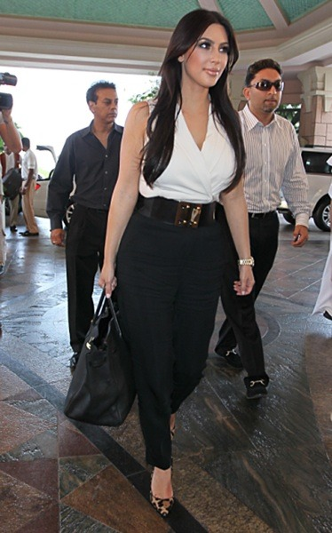 Kim Kardashian in black slacks