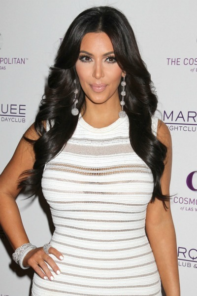 Kim Kardashian's long, loose curls for oblong faces