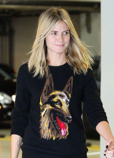 Heidi Klum in a dog sweater