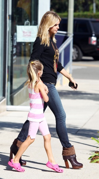 Heidi Klum in chocolate brown booties