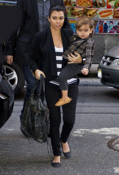 Kourtney Kardashian in cropped jacket