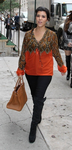 Kourtney Kardashian in orange