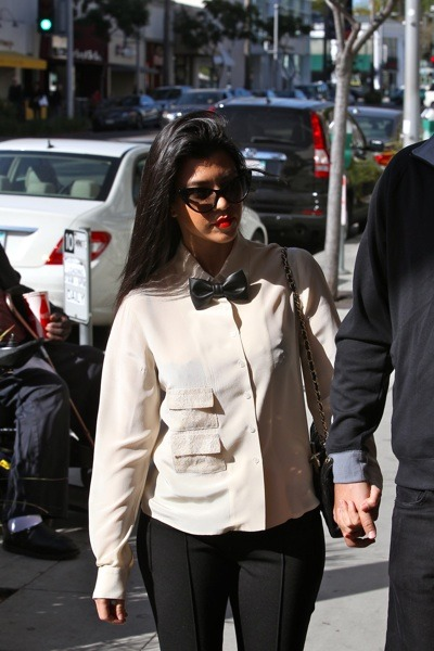 Kourtney Kardashian in a bow-tie