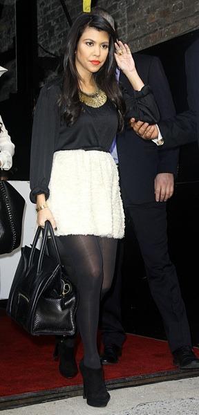 Kourney Kardashian with a gold choker
