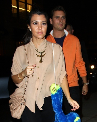 Kourtney Kardashian with gold necklace