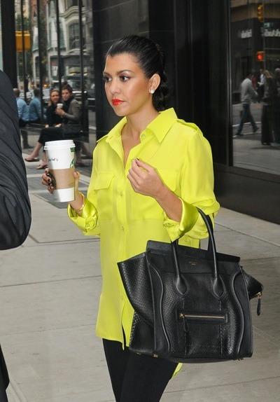 Kourtney Kardashian in bright yellow