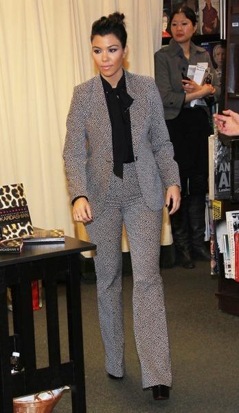 Kourtney Kardashian in a patterned suit