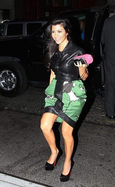 Kourtney Kardashian in green skirt