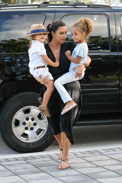 Kim gets some practice being a mommy