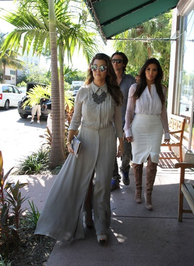 Kourtney and Kim walk the streets of Miami