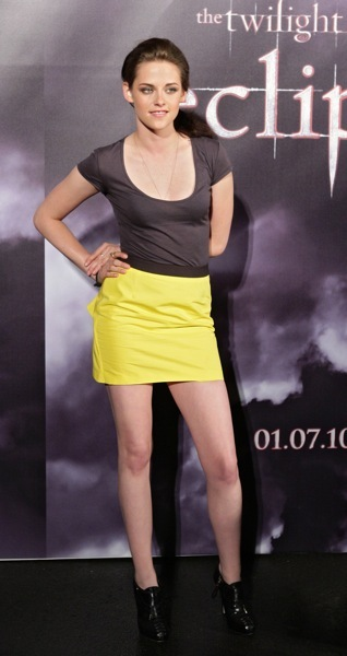 Kristen Stewart in a yellow mini skirt