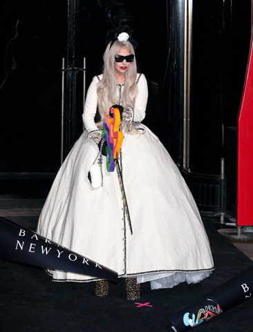 Lady Gaga cutting the ribbon at Barneys