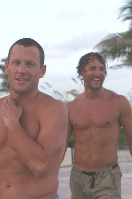 Lance Armstrong and Matthew McConaughey near the water