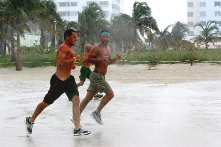 Lance Armstrong and Matthew McConaughey run in the rain