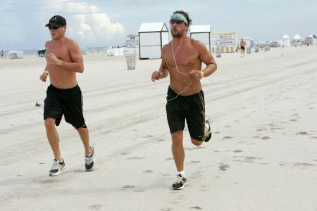 Lance Armstrong and Matthew McConaughey run on the beach