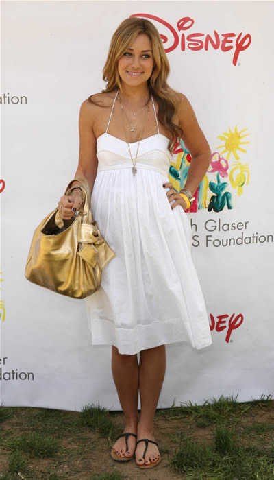 L.C. looks very girl-next-door in this white cotton dress.