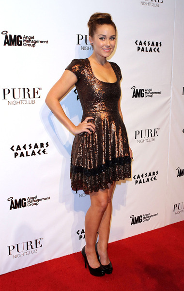 Birthday girl! L.C. poses on the red carpet on her 25th birthday in a bronze sequin number.