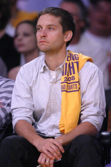 Leonardo DiCaprio has a Lakers t-shirt on his shoulder while at a basketball ...