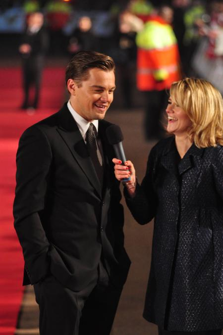 Leonardo DiCaprio grants an interview during the premiere of his movie