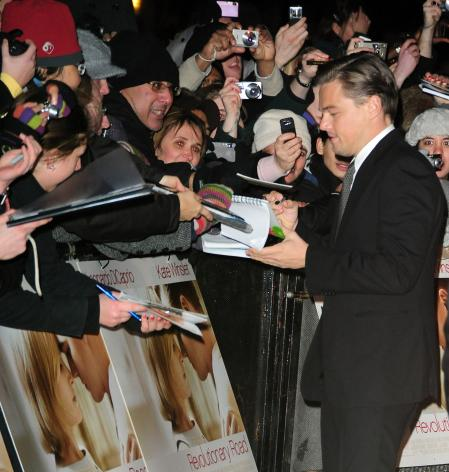 Leonardo DiCaprio signs autographs for fans at a movie premiere