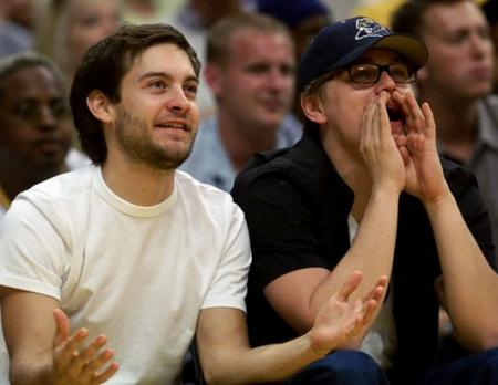 Leonardo DiCaprio and Tobey Maguire watch the Lakers play basketball
