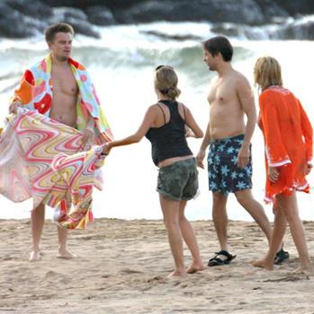 Leonardo DiCaprio and Tobey Maguire relax at the beach in Hawaii