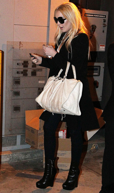 Lindsay Lohan goes Christmas shopping at Yves Saint Laurent
