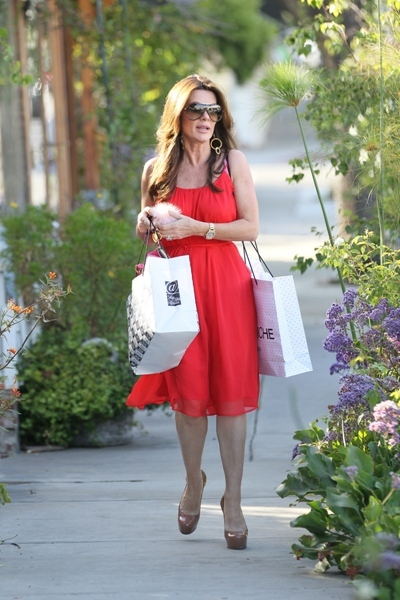 Lisa Vanderpump strolls through LA in neon dress