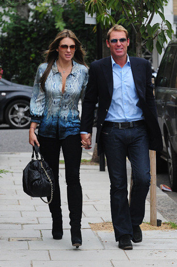 Elizabeth Hurley holds hands with her BF