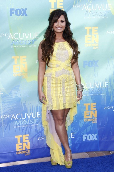 Demi Lovato in yellow and green dress