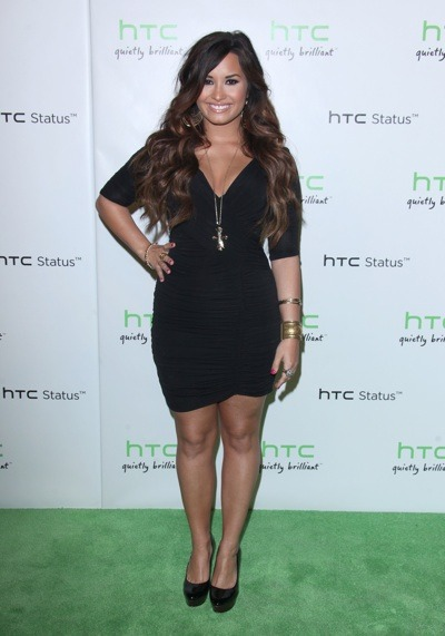 Demi Lovato with cross necklace