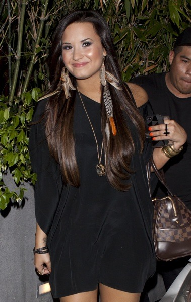 Demi Lovato with feather earrings