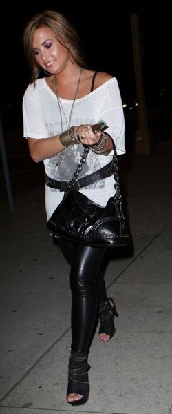 Demi Lovato in leather leggings