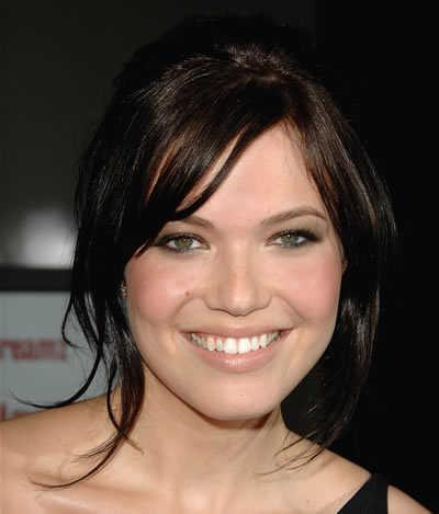 Mandy Moore's Brunette Pulled Back Hairstyle with Bangs