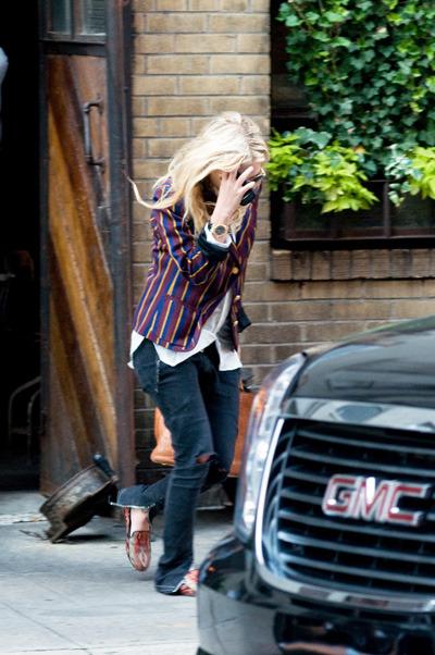 Mary-Kate Olsen tries to escape the paparazzi in NYC while out in Manhattan. Photo courtesy of Ivan Nikolov/WENN.