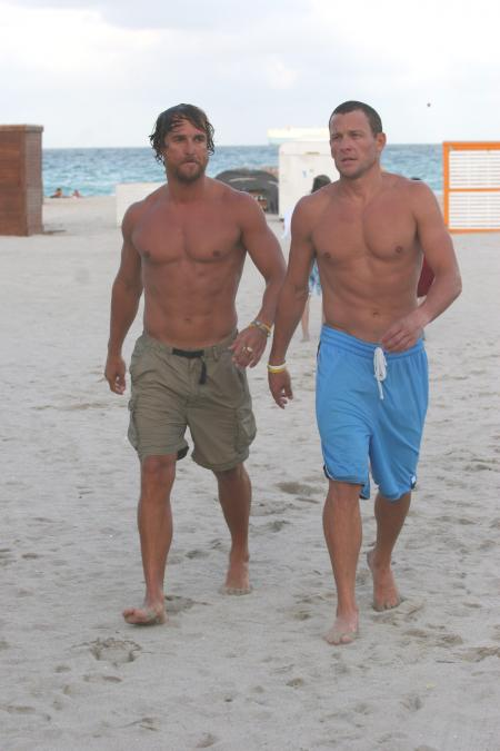 Matthew McConaughey and Lance Armstrong come in from the water