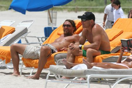 Matthew McConaughey and Lance Armstrong laugh at the beach