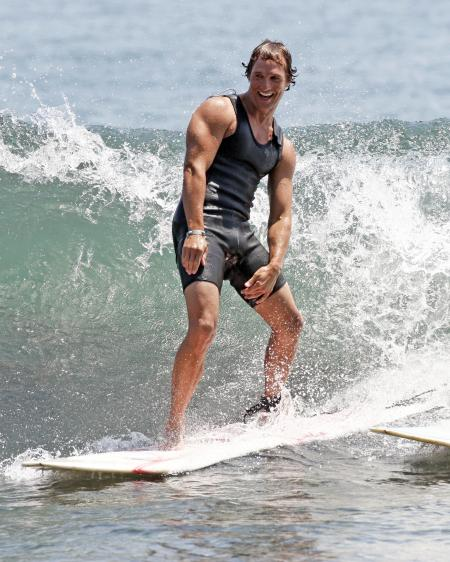 Matthew McConaughey surfing in Malibu